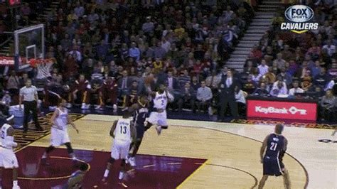 Kyrie Irving tosses a 1-handed, full court jump assist
